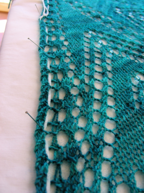 Pinning the edge of a shawl for blocking