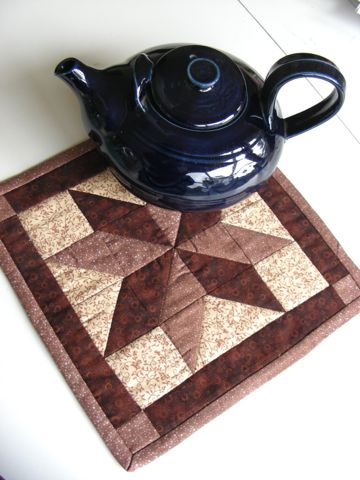 Hand-quilted star patch teapot mat