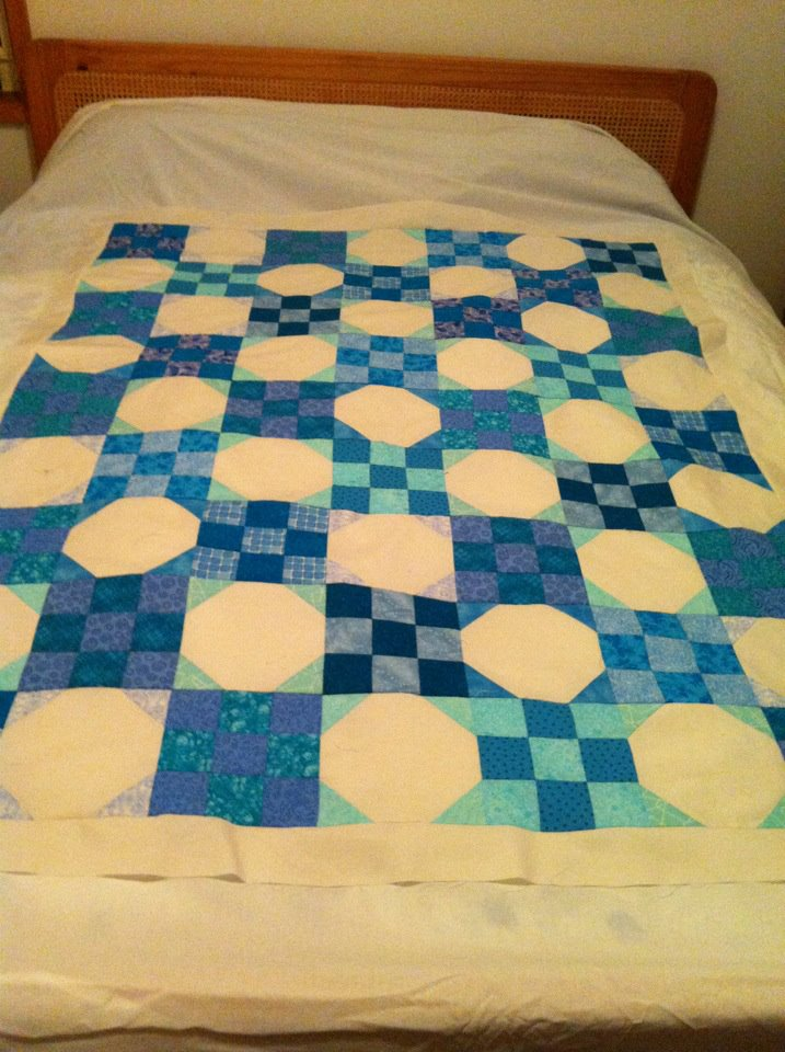 Nine-patch and snowball quilt top in progress
