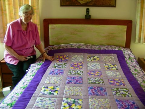 Hand made quilt with floral fabrics
