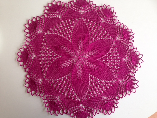 Deep pink hand-knitted doily