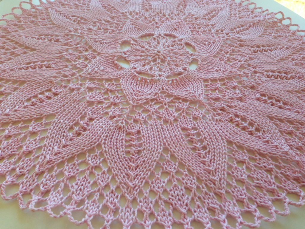 Hand knitted pink cotton doily