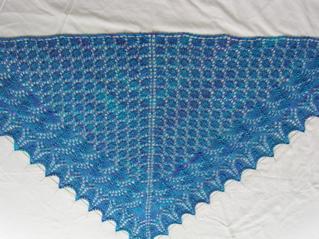 Pattern: Swallowtail Shawl by Evelyn Clark. Yarn: Handmaiden Sea Silk