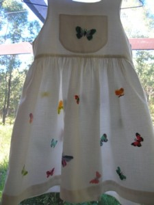 Cross-stitched butterfly pinafore