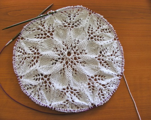 Knitted lace doily in progress