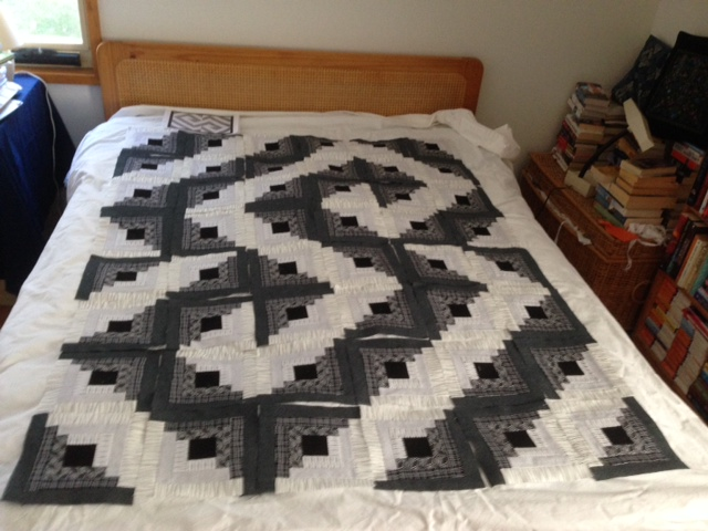 Log cabin quilt blocks laid out in asymmetrical design