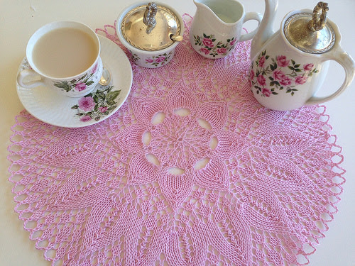 Pink cotton hand knitted doily with rose bone china tea set